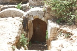 At the entrance to the cave one finds a complete rolling stone. These stones would block the entrance to the cave and could be rolled back when needed. The use of rolling stones (called: golel) and family burial caves was very common among the Jews of Jerusalem, especially during the Second Temple Period. (Cf. Matthew, 28:2).  Picture Credit: Segula Magazine